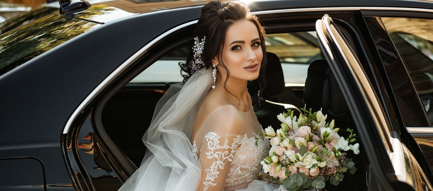 Brunette Bridal photos showing bride stepping out of car